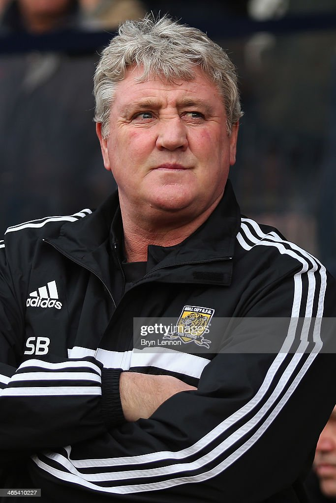 Hull City Manager <a gi-track='captionPersonalityLinkClicked' href=/galleries/search?phrase=Steve+Bruce+-+Soccer+Manager&family=editorial&specificpeople=208832 ng-click='$event.stopPropagation()'>Steve Bruce</a> looks on prior to the FA Cup Fourth Round match between Southend United and Hull City at Roots Hall on January 25, 2014 in Southend, England.