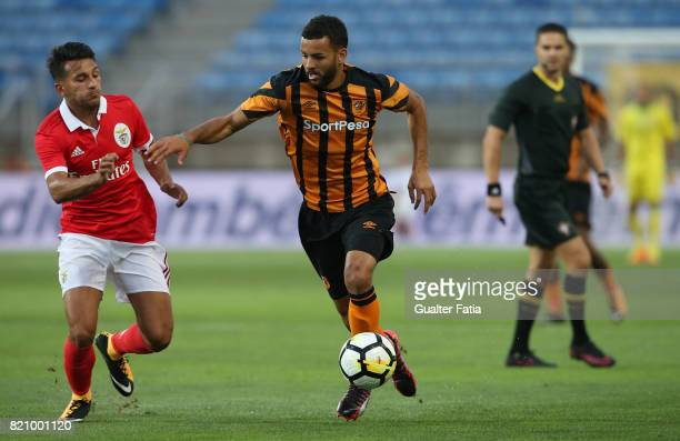 Hull City midfielder Kevin Stewart with Benfica's midfielder Joao Carvalho from Portugal in action during the Algarve Cup match between SL Benfica...