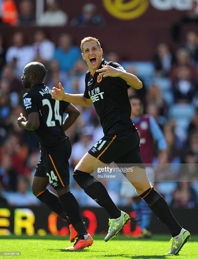 Hull City player <a gi-track='captionPersonalityLinkClicked' href=/galleries/search?phrase=Michael+Dawson&family=editorial&specificpeople=453217 ng-click='$event.stopPropagation()'>Michael Dawson</a> (r) celebrates his sides first goal during the Barclays Premier League match between Aston Villa and Hull City at Villa Park on August 31, 2014 in Birmingham, England.
