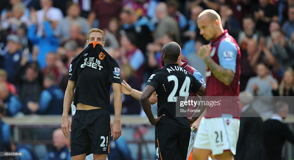 Hull City player <a gi-track='captionPersonalityLinkClicked' href=/galleries/search?phrase=Michael+Dawson&family=editorial&specificpeople=453217 ng-click='$event.stopPropagation()'>Michael Dawson</a> (c) reacts after the Barclays Premier League match between Aston Villa and Hull City at Villa Park on August 31, 2014 in Birmingham, England.