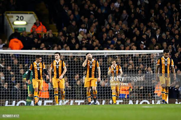 Hull City players show their dejection after Tottenham's second goal during the Premier League match between Tottenham Hotspur and Hull City at White...