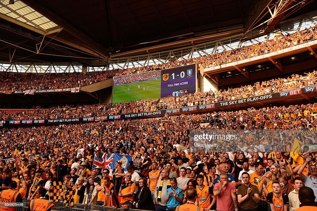 Hull City supporters celebrates their team's win and promotion to the Premier League after Sky Bet Championship Play Off Final match between Hull City and Sheffield Wednesday at Wembley Stadium on May 28, 2016 in London, England.