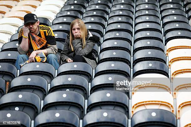 Hull City supporters show their dejection after their team was relegated from the Premier League after the Barclays Premier League match between Hull...