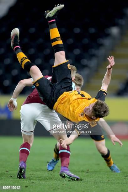 Hull City U21 Josh Tymon falls awkwardly as is challenged by West Ham United u21 Alex Pike