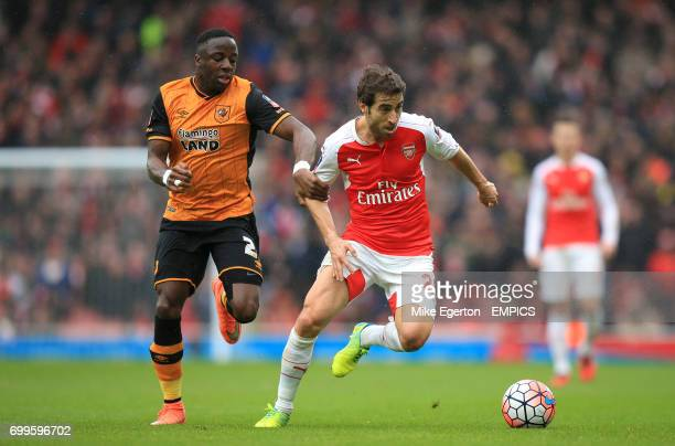 Hull City's Adama Diomande and Arsenal's Mathieu Flamini battle for the ball
