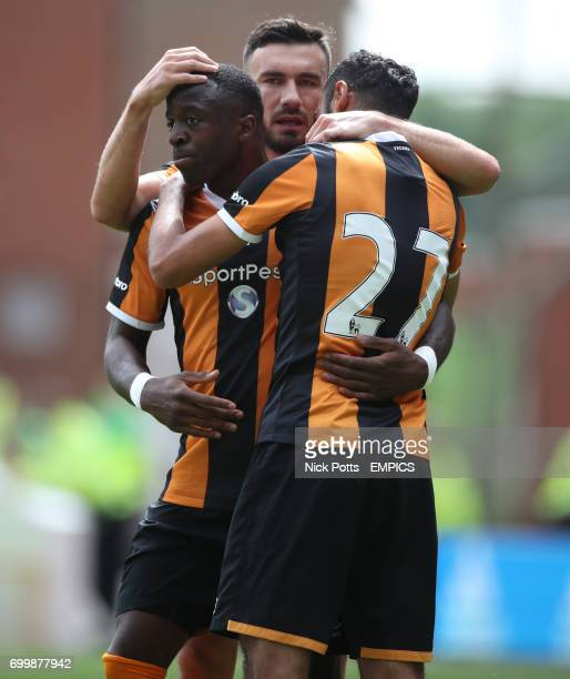 Hull City's Adama Diomande celebrates scoring his second goal against Nottingham Forest's with Hull City's Robert Snodgrass and Hull City's Ahmed...