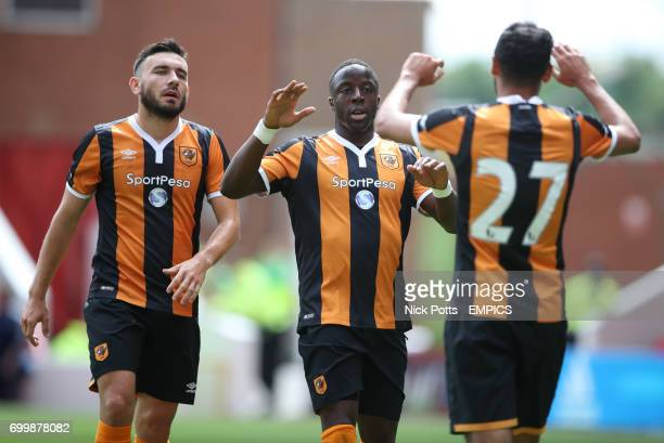 Hull City's Adama Diomande celebrates scoring his second goal of the match with team mates Robert Snodgrass and Hull City's Ahmed Elmohamady