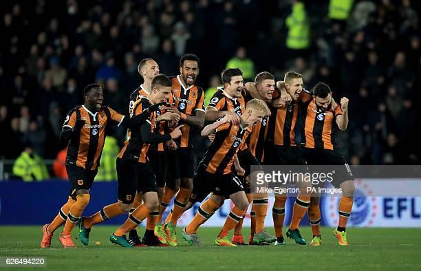 Hull City's Adama Diomande Markus Henriksen David Meyler Tom Huddlestone Harry Maguire James Weir Josh Tymon Michael Dawson and Robert Snodgrass...