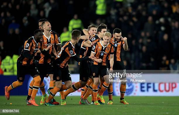 Hull City's Adama Diomande Tom Huddlestone David Meyler Markus Henriksen Josh Tymon Harry Maguire James Weir and Robert Snodgrass celebrate winning...