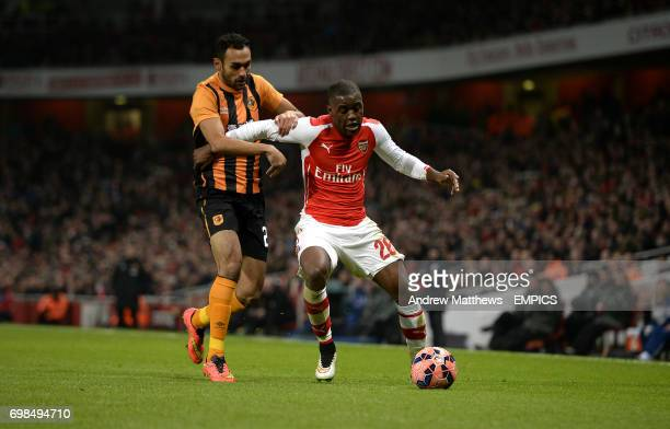 Hull City's Ahmed Elmohamady and Arsenal's Joel Campbell battle for the ball