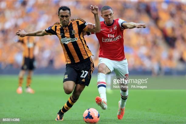 Hull City's Ahmed Elmohamady and Arsenal's Kieran Gibbs battle for the ball