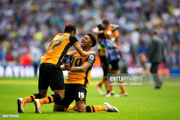 Hull City's Ahmed Elmohamady and Chuba Akpom celebrate after the final whistle