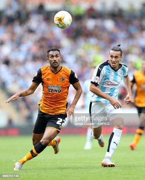 Hull City's Ahmed Elmohamady and Huddersfield Town's Jason Davidson battle for the ball