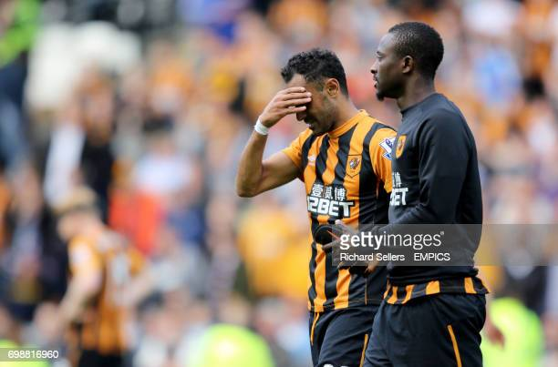 Hull City's Ahmed Elmohamady and Hull City's Dame N'Doye after Hull City are relegated