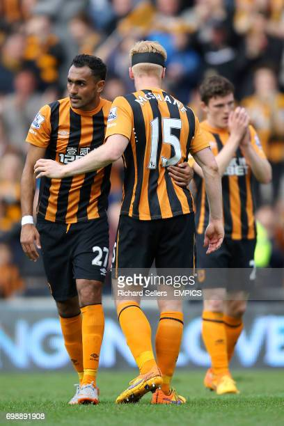 Hull City's Ahmed Elmohamady and Hull City's Paul McShane console each other after the final whistle