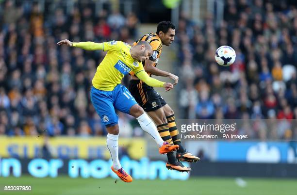 Hull City's Ahmed Elmohamady and Newcastle United's Yoan Gouffran battle for the ball