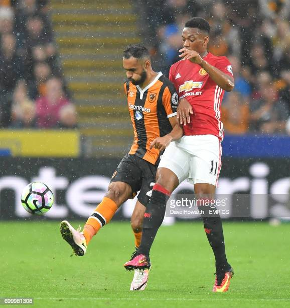 Hull City's Ahmed Elmohamady battles with Manchester United's Anthony Martial