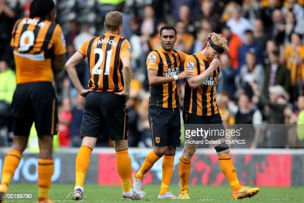 Hull City's Ahmed Elmohamady consoles Hull City's Paul McShane