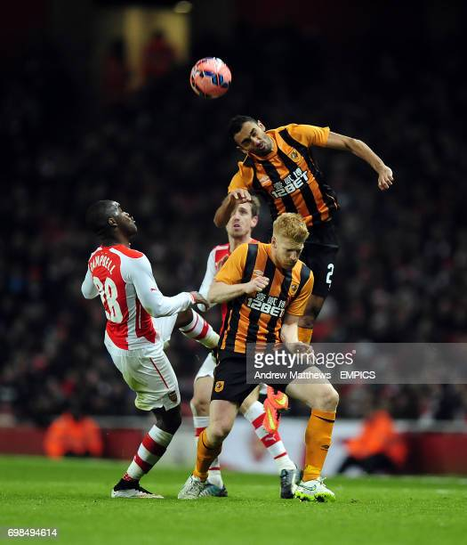 Hull City's Ahmed Elmohamady rises highest to head the ball away from Arsenal's Joel Campbell