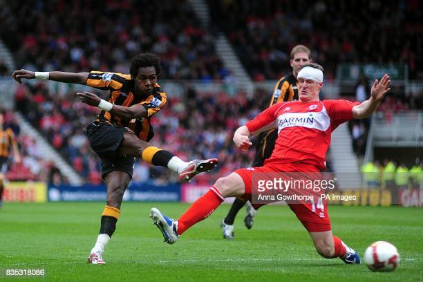 Hull City's Alberto Manucho has a shot on goal under pressure from Middlesbrough's Robert Huth