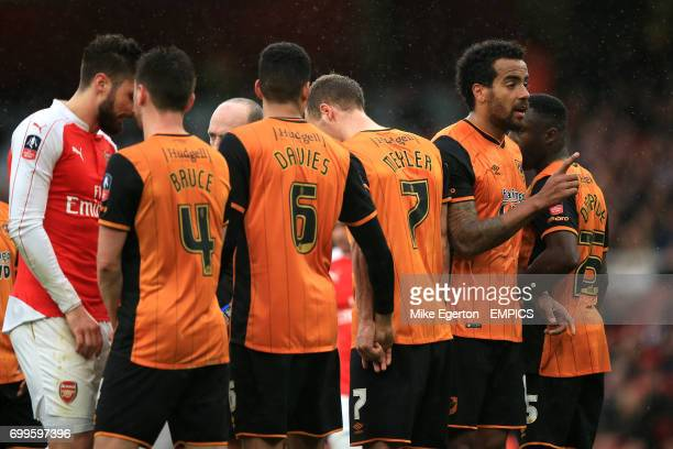 Hull City's Alex Bruce Curtis Davies David Meyler Tom Huddlestone and Adama Diomande form a defensive wall