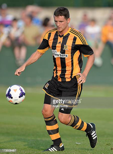 Hull City's Alex Bruce plays the ball North Ferriby during a preseason friendly at the Eon Visual Media Stadium on July 15 2013 in North Ferriby...