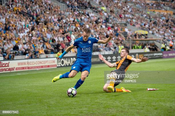 Hull City's Andy Robertson challenges and Leicester City's Jamie Vardy
