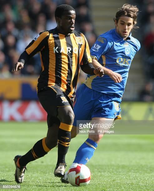 Hull City's Bernard Mendy and Portsmouth's Niko Kranjcar battle for the ball