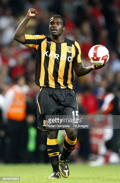 Hull City's Bernard Mendy celebrates in front of the away fans after his side beat Arsenal