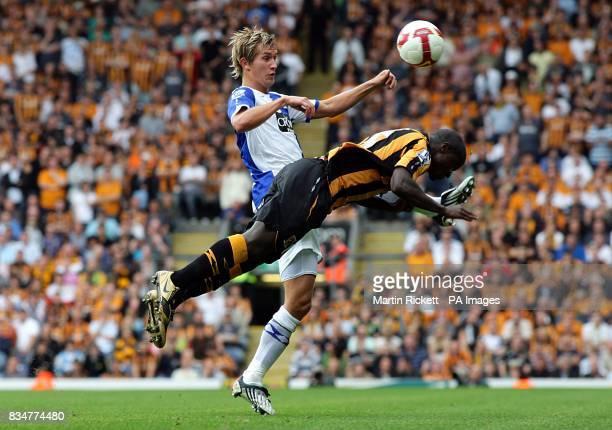 Hull City's Bernard Mendy clears the ball under pressure from Blackburn Rovers' Morten Gamst Pedersen