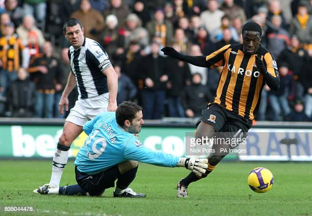 Hull City's Bernard Mendy goes round West Bromwich Albion's goalkeeper Scott Carson to score the first goal
