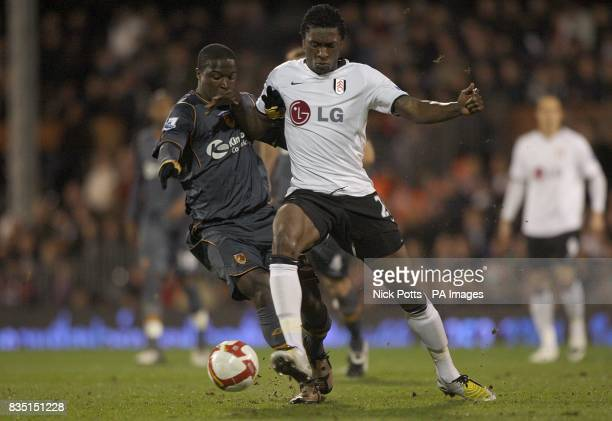 Hull City's Bernard Mendy is fouled by Fulham's Dickson Etuhu as they battle for the ball