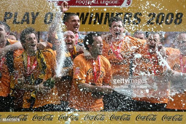 Hull City's captain Ian Ashbee leads the celebrations