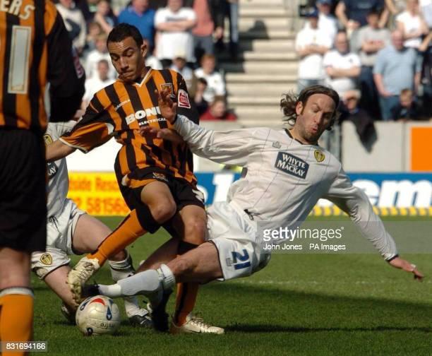 Hull City's Craig Fagan challenges Leeds' Shaun Derry during the CocaCola Championship match at the KC Stadium Hull Saturday April 1 2006 PRESS...
