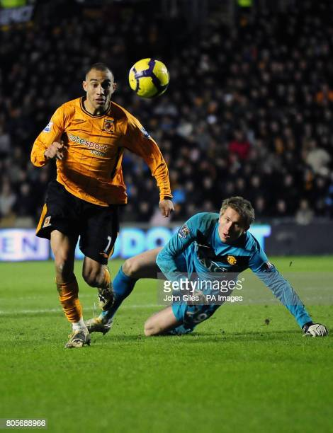 Hull City's Craig Fagan gets past Manchester United goalkeeper Tomasz Kuszczak during the Barclays Premier League match at the KC Stadium Hull