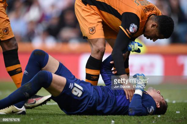 Hull City's Curtis Davies helps team mate goalkeeper Eldin Jakupovic