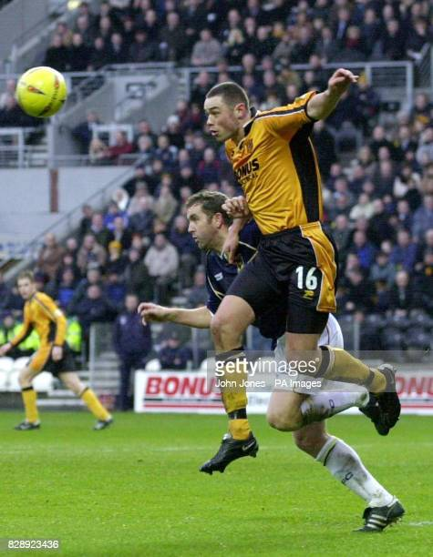 Hull City's Damien Delaney and Oxford United's Paul McCarthy in action during their Nationwide Division Three match at Hull's Kingston Communications...