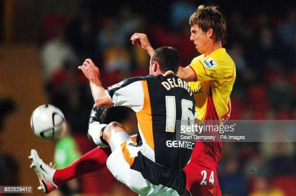 Hull City's Damien Delaney challenges Watford's Tamas Priskin during the Carling Cup third round at Vicarage Road Watford