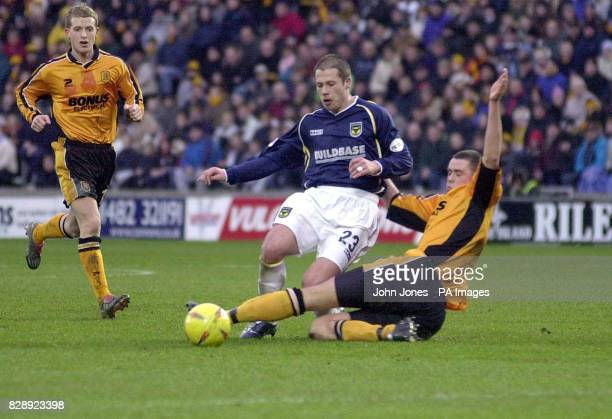 Hull City's Damien Delaney tackles Oxford's Steve Basham during their Nationwide Division Three match at Hull's Kingston Communications Stadium THIS...