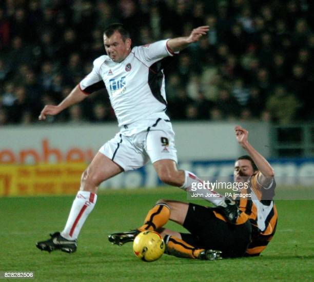 Hull City's Damien Delaney tackles Sheffield United's Neil Shipperley during the CocaCola Championship match at the Kingston Communications Stadium...