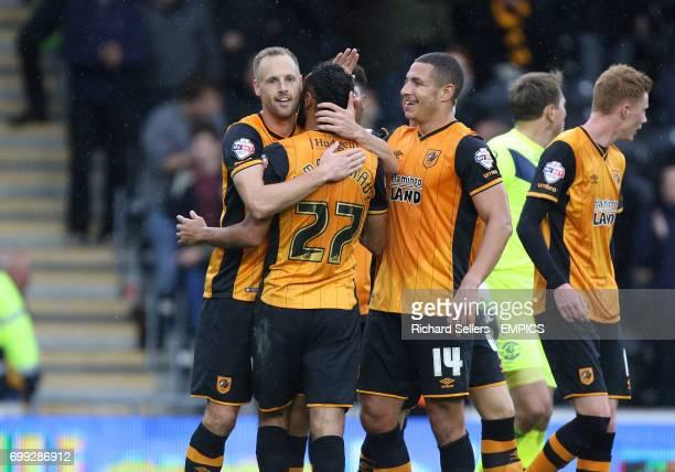 Hull City's David Meyler celebrates with Hull City's Ahmed Elmohamady and Hull City's Jake Livermore