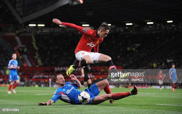 Hull City's David Meyler slides in on Manchester United's Adnan Januzaj