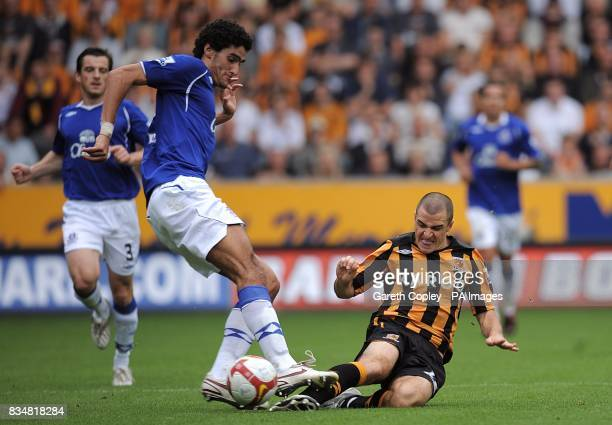 Hull City's Dean Marney slides in to challenge Everton's Marouane Fellaini