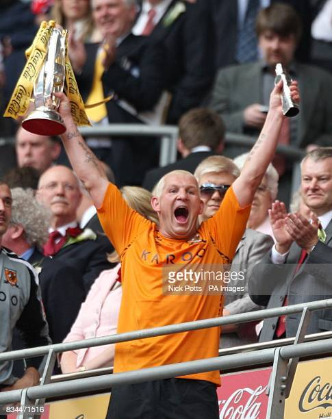 Hull City's Dean Windass lifts the Championship play off trophy