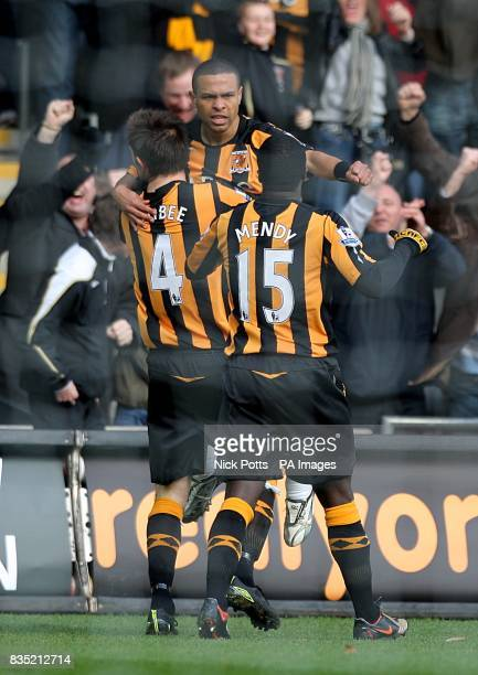 Hull City's Deiberson Geovanni celebrates with his team mates Ian Ashbee and Bernard Mendy after he scores his sides opening goal of the game
