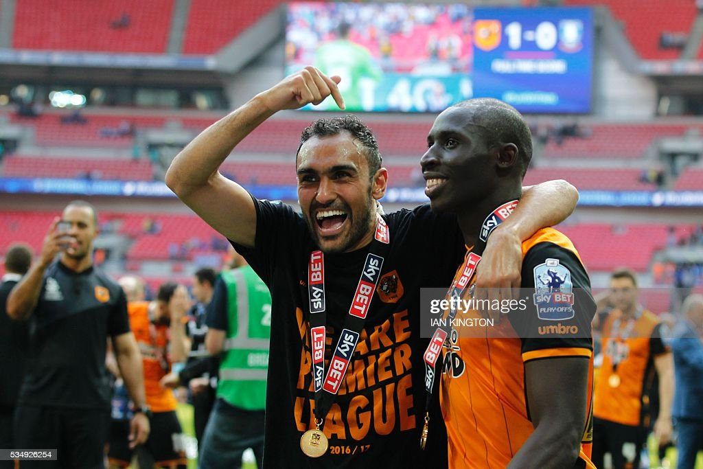 Hull City's Egyptian midfielder Ahmed Elmohamady (L) and Hull City's French-born Senegalese midfielder Mohamed Diame (R) celebrate after Hull City won the English Championship play-off final football match between Hull City and Sheffield Wednesday at Wembley Stadium in London on May 28, 2016. Hull City secured promotion to the Premier League with a 1-0 victory in the Championship play-off final at Wembley against Yorkshire rivals Sheffield Wednesday. / AFP / Ian Kington / NOT