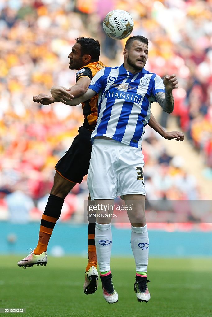 Hull City's Egyptian midfielder Ahmed Elmohamady (L) vies with Sheffield Wednesday's midfielder Daniel Pudil (R) during the English Championship play-off final football match between Hull City and Sheffield Wednesday at Wembley Stadium in London on May 28, 2016. / AFP / Ian Kington / NOT