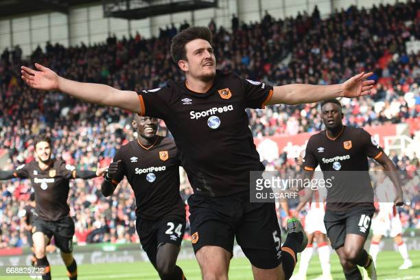 Hull City's English defender Harry Maguire celebrates scoring Hull's first goal during the English Premier League football match between Stoke City...