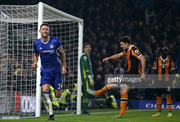 Hull City's English defender Harry Maguire reacts as Chelsea's English defender Gary Cahill celebrates scoring their second goal during the English...