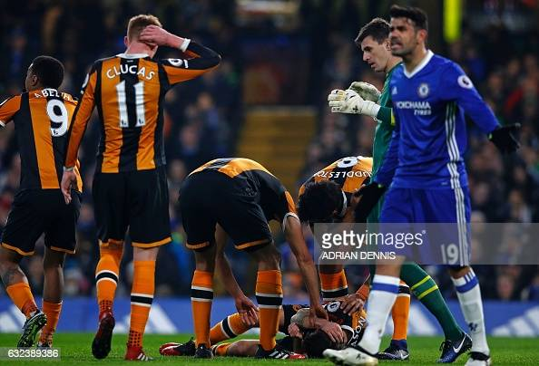 Hull City's English midfielder Ryan Mason lies injured after a clash of heads with Chelsea's English defender Gary Cahill during the English Premier...
